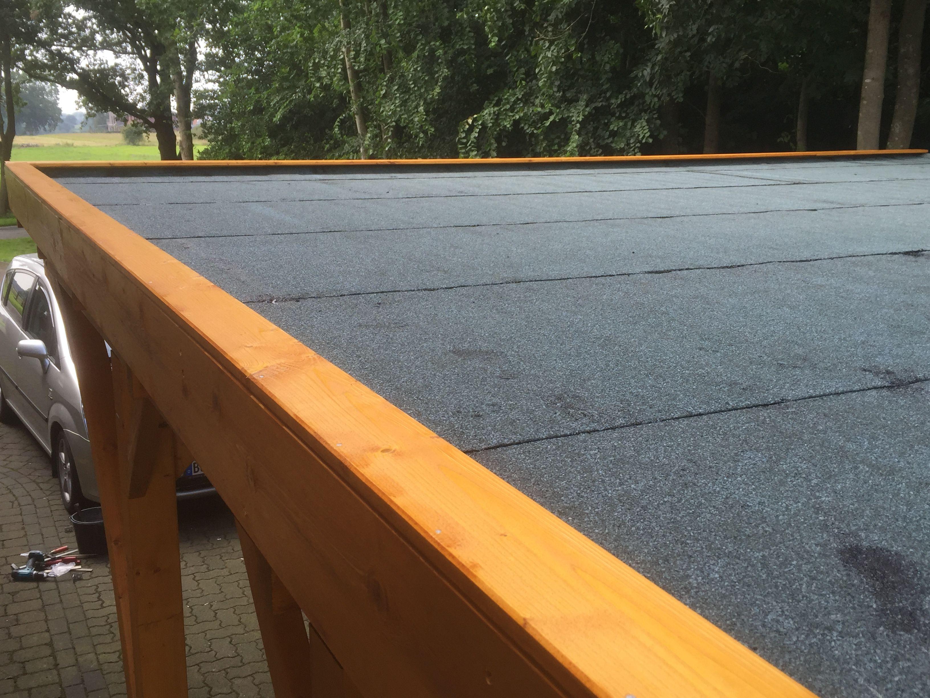 Carport in Fichte mit Leimholzbogen, Holzblende