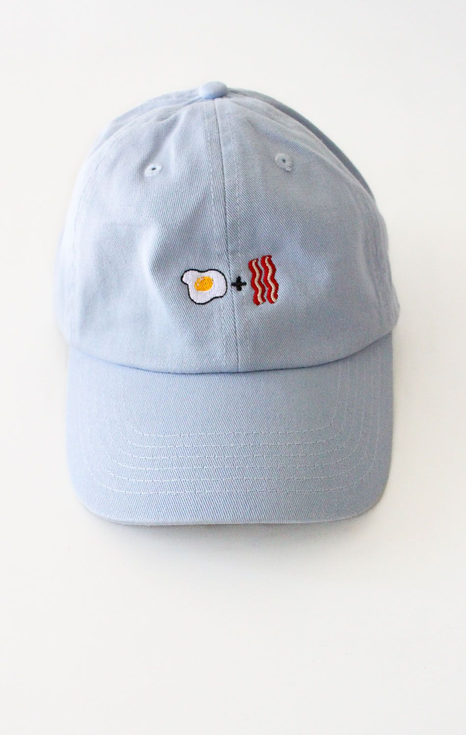 f91d06605d1a4 Description Details  Six panel cap in light blue with  Egg + Bacon   embroidery…