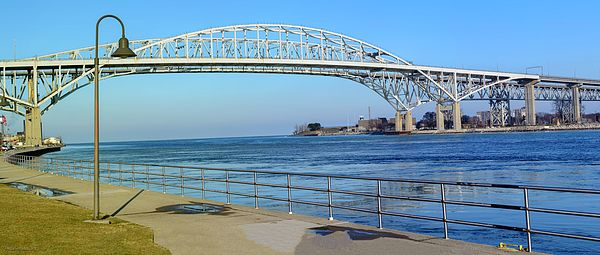 Pano Blue Water Bridge Michigan by LeeAnn McLaneGoetz McLaneGoetzstudioLLC.com  The Blue Water Bridge is a twin-span international bridge across the St. Clair River that links Port Huron, Michigan, United States, and Point Edward, Ontario, Canada. The Blue Water Bridge connects Highway 402 in Ontario with both Interstate 69 (I-69) and I-94 in Michigan.  The original span is a cantilever truss bridge with a total length of 6,178 feet (1,883 m) and a main span of 871 feet (265 m).