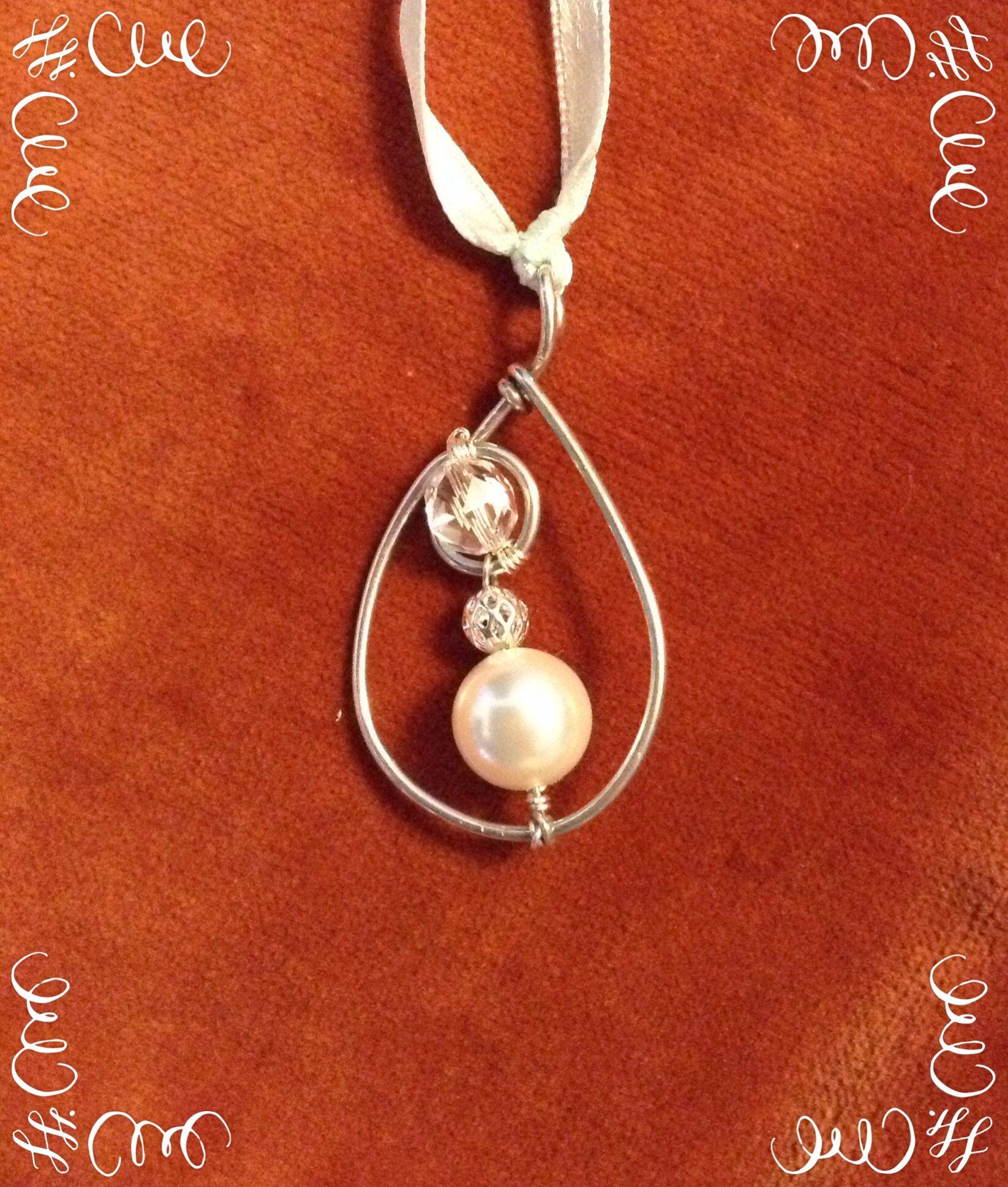 Handmade, 925 Sterling Silver wire with Swarovski bead and Quartz bead.