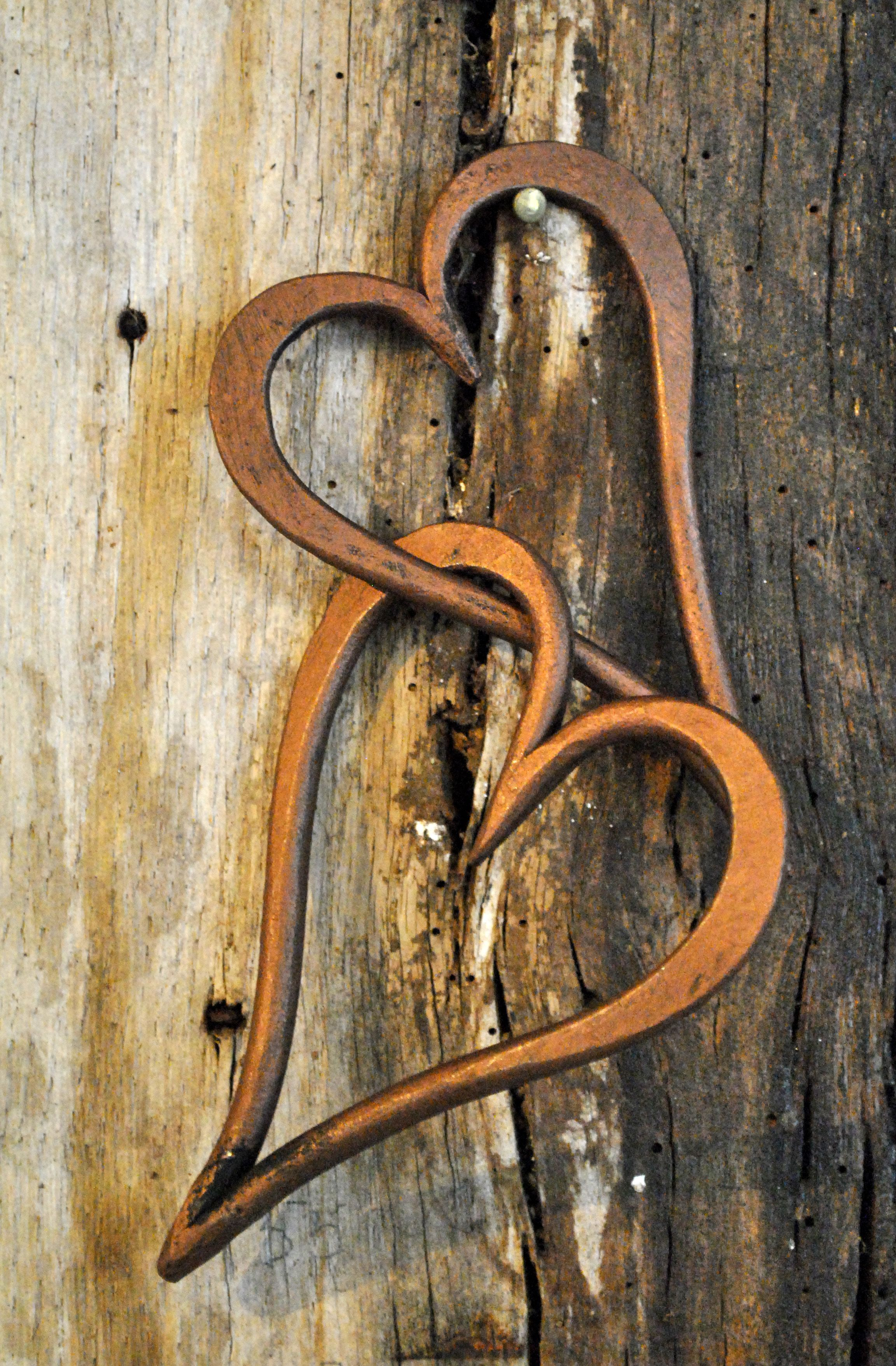 Hand linked hearts in a bronze wax finish