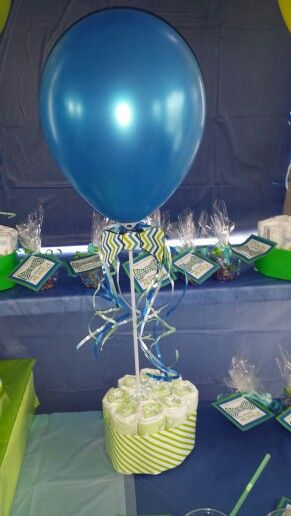 Balloon centerpieces with bowtie or tiaras on them would