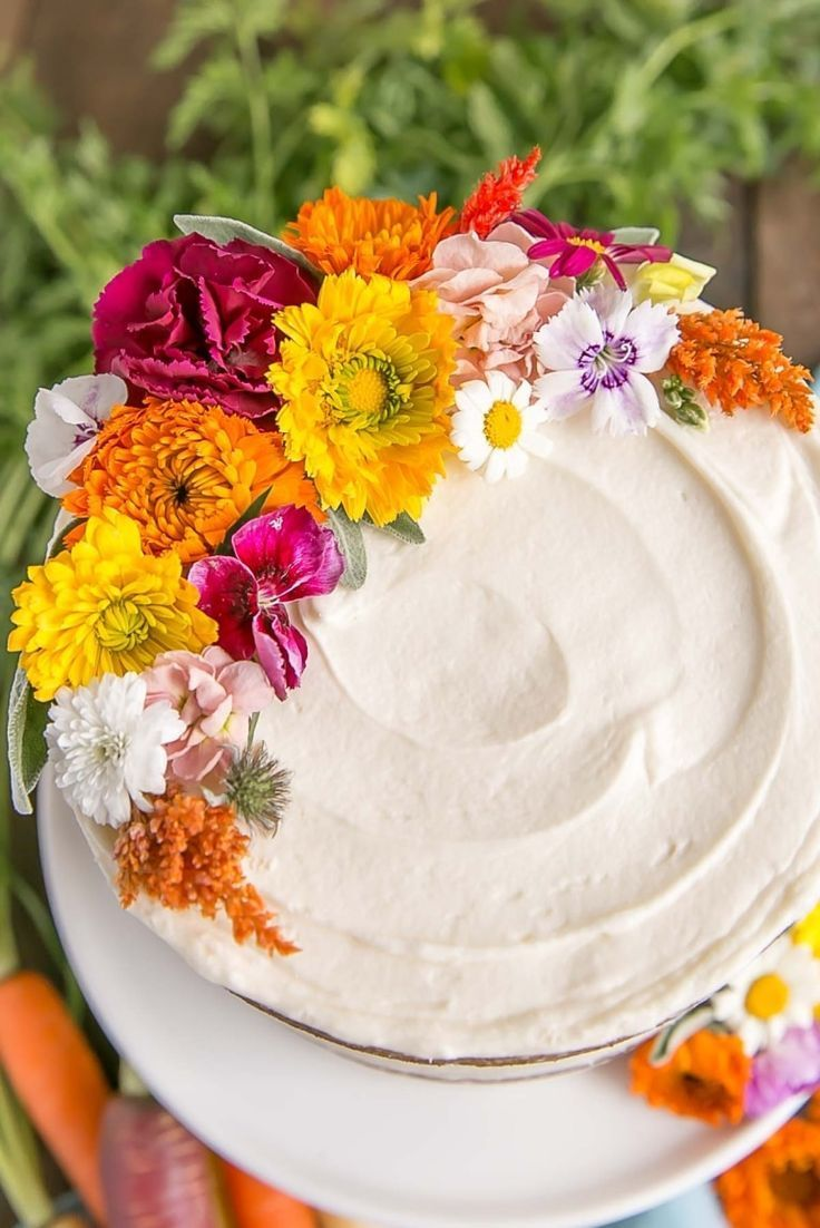 Close up of edible flowers on carrot cake cake ideas