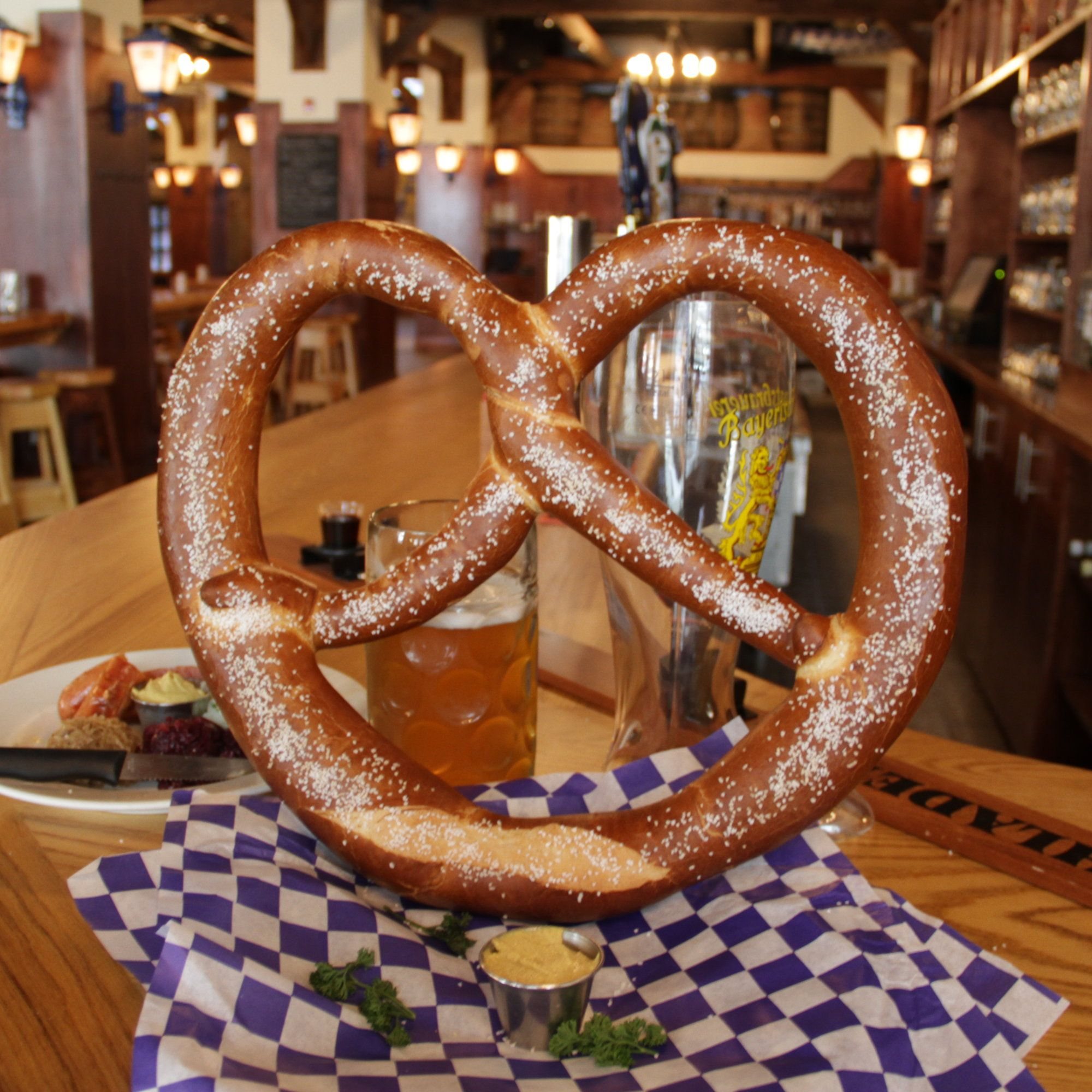 This beer hall has the biggest pretzel you\'ve ever seen... and shot ...