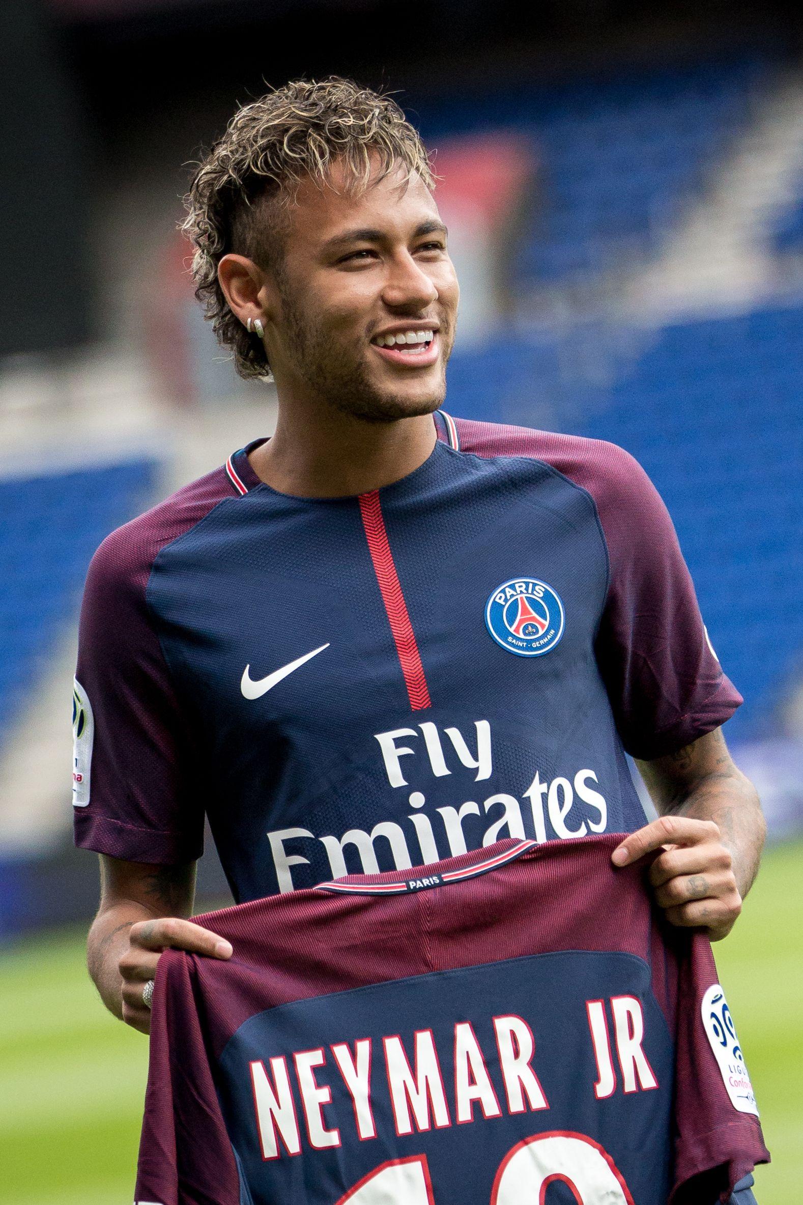 NeymarJr holding up his PSG jersey Fan360 Neymar