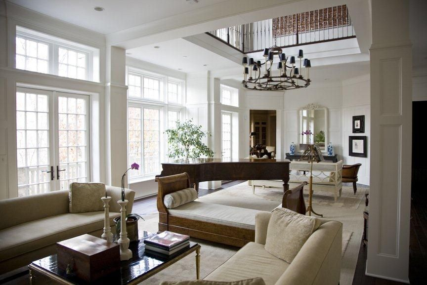 A Large Chandelier Anchors The Double Height Ceilings In This