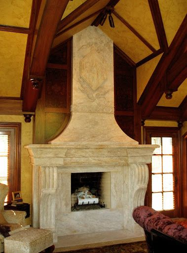Take a look at this beautiful fireplace design! It features intricate carved details. Click on the picture to view more stone designs. #Natural #Stone #Fireplace #Design