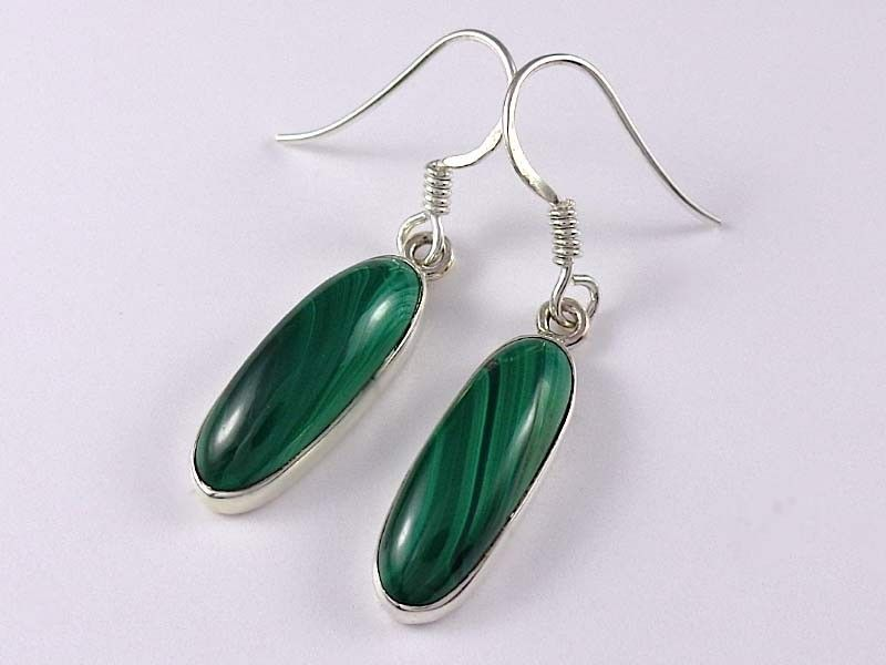 Oval design sterling silver malachite earrings. Lovely oval design sterling silver dangle earrings with cabochon malachite gemstone and fine details throughout