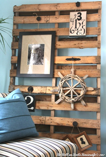 This Pallet Board Simply Leans Against The Wall And Serves As A Display Knobs Handles Were Attached Lovely Driftwood Wheel Is In Mix