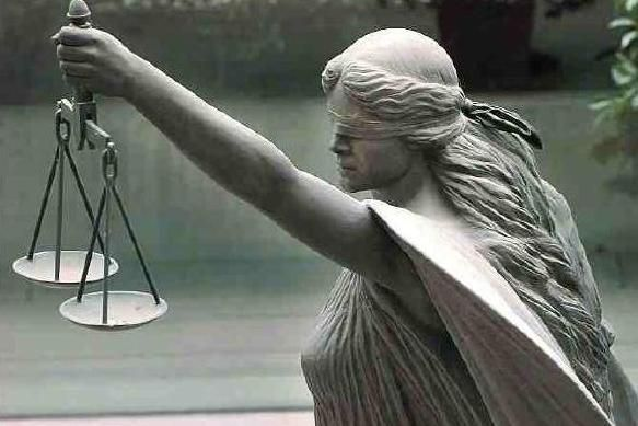 Or is the blind woman Lady Justice?