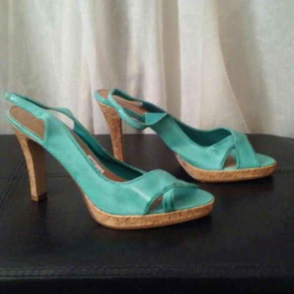 Turquoise High Heels Sandals Pumps- size 8.5  nwt Turquoise Platform Pump   Excellent condition   New without the box   Size 8.5   4 inch heels   Manmade material   This gorgeous pump is very stylish and sophisticated. From the distressed aqua blue color to the cork platform and heel, you will be sure to turn heads in these pumps for the right reasons. Can be worn with any outfit for a finished and polished look. Shoes Heels