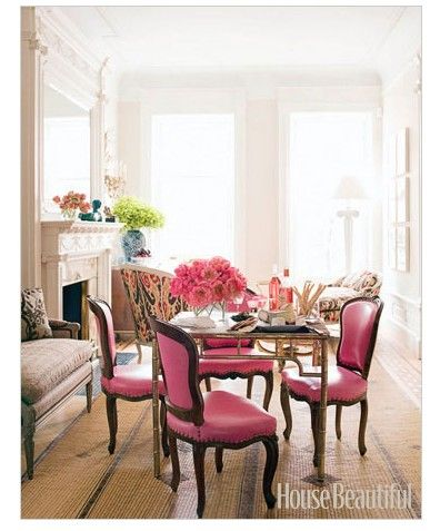 like the pink covered chairs used in this little dining area For