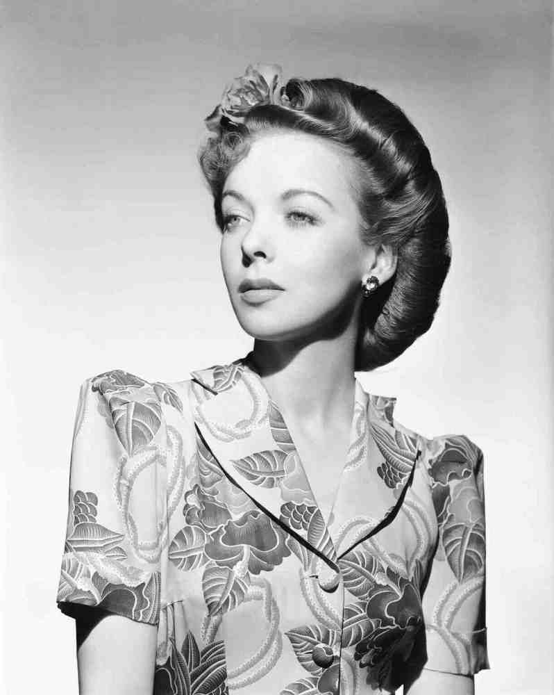 """Ida Lupino, 1944, with her hair in""""Victory Rolls"""". Hollywood helped popularize the style so that women replacing men in defense plants and factories during World War II could work safely."""
