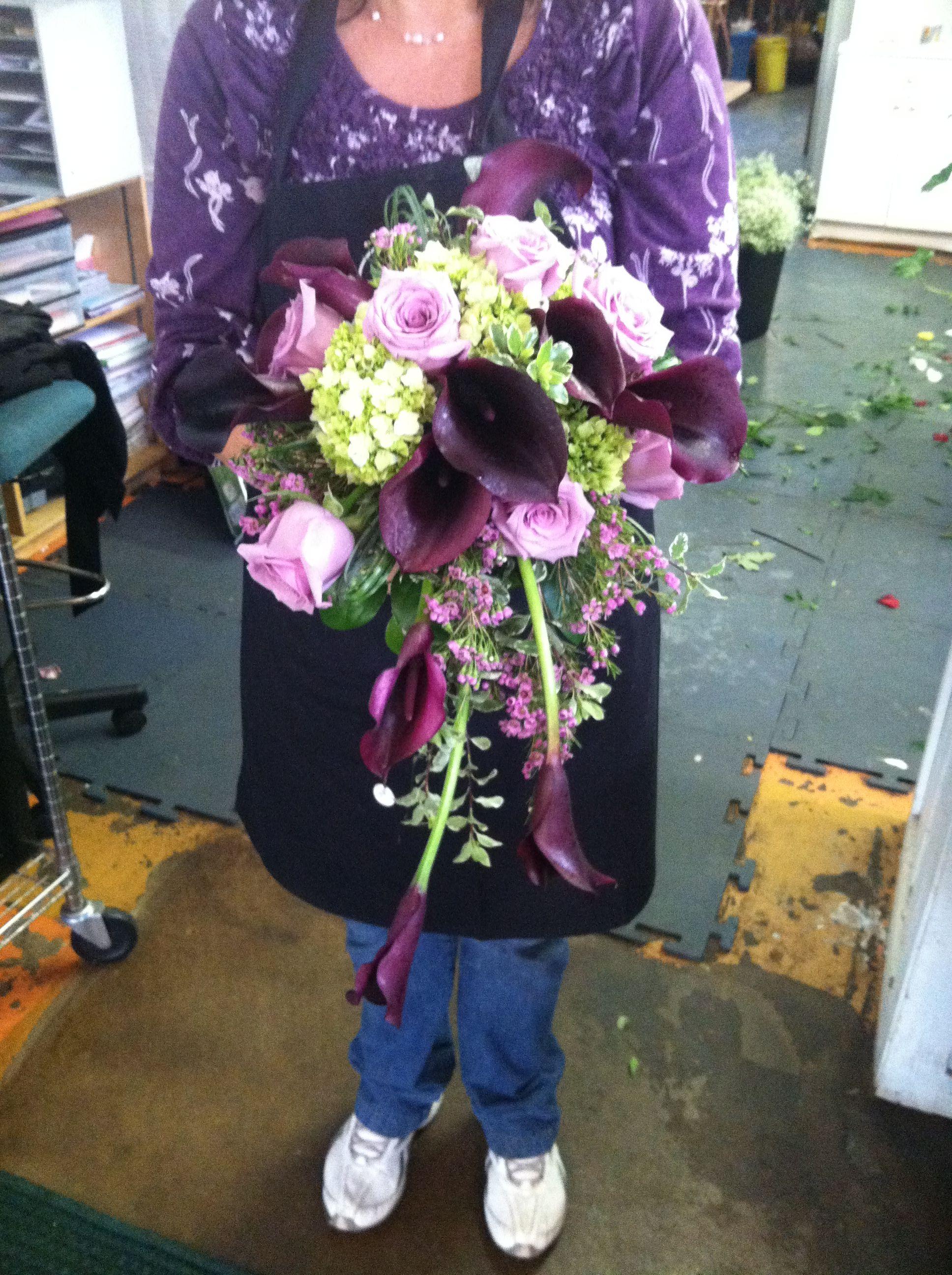 Cascading bridal bouquet with eggplant calla lilies, ocean
