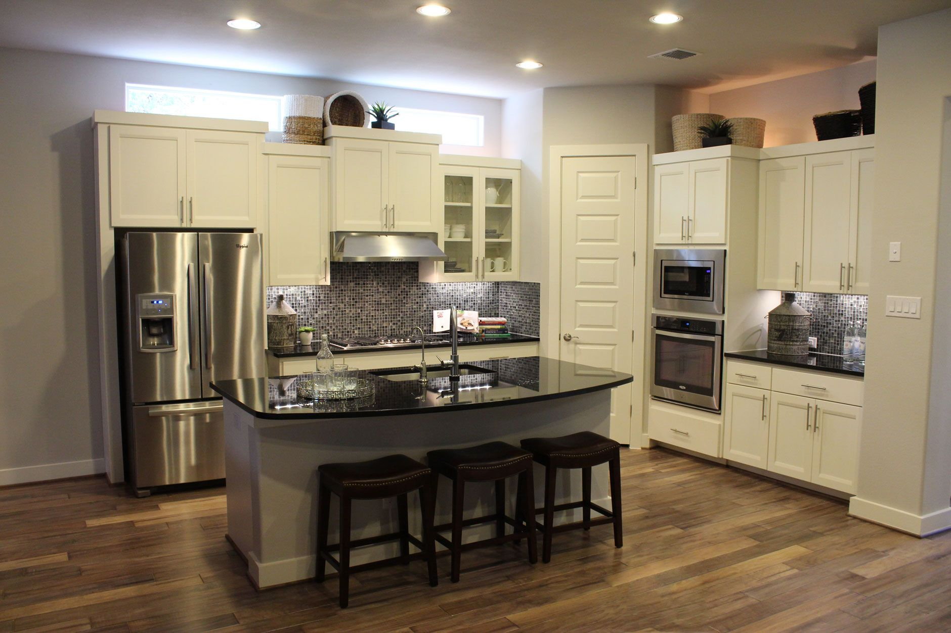 White kitchen with transitional combination frame