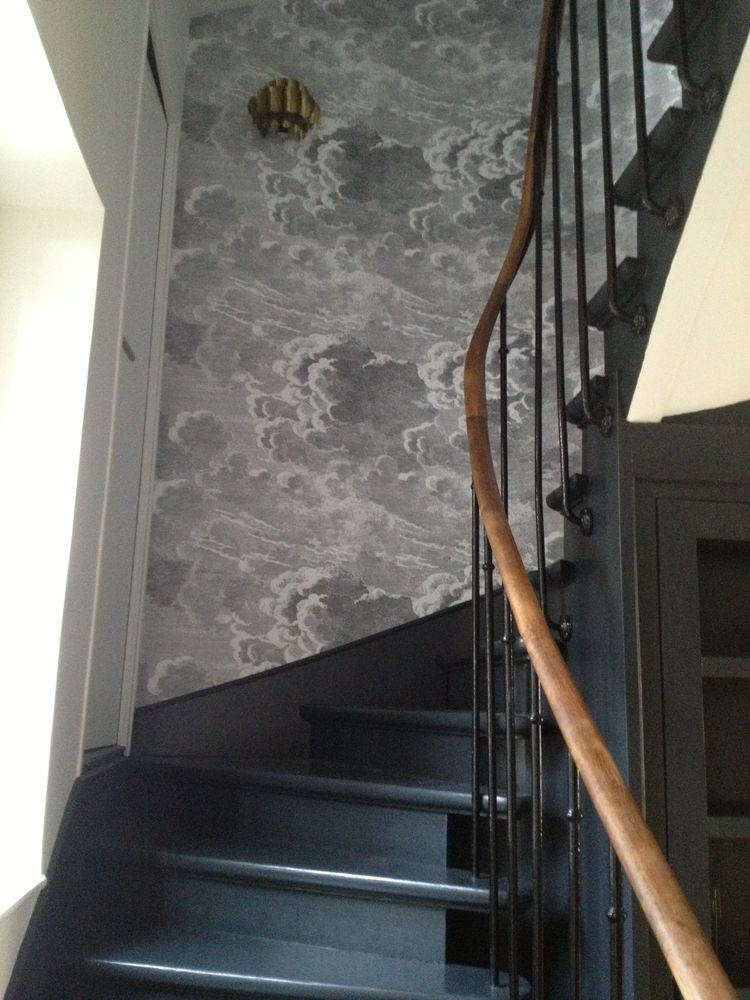 The Black Painted Steps Are Perfect Contrast To The Fornasetti