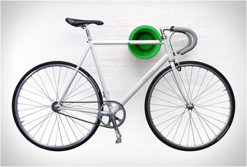 The Cycloc is a stylish award-winning bike storage system that mounts on a wall using a simple design and your bikeu0027s own weight to hold it in place.  sc 1 st  Pinterest & cycloc-bicycle-storage-2 | Estado del Arte - ArtiD | Pinterest ...