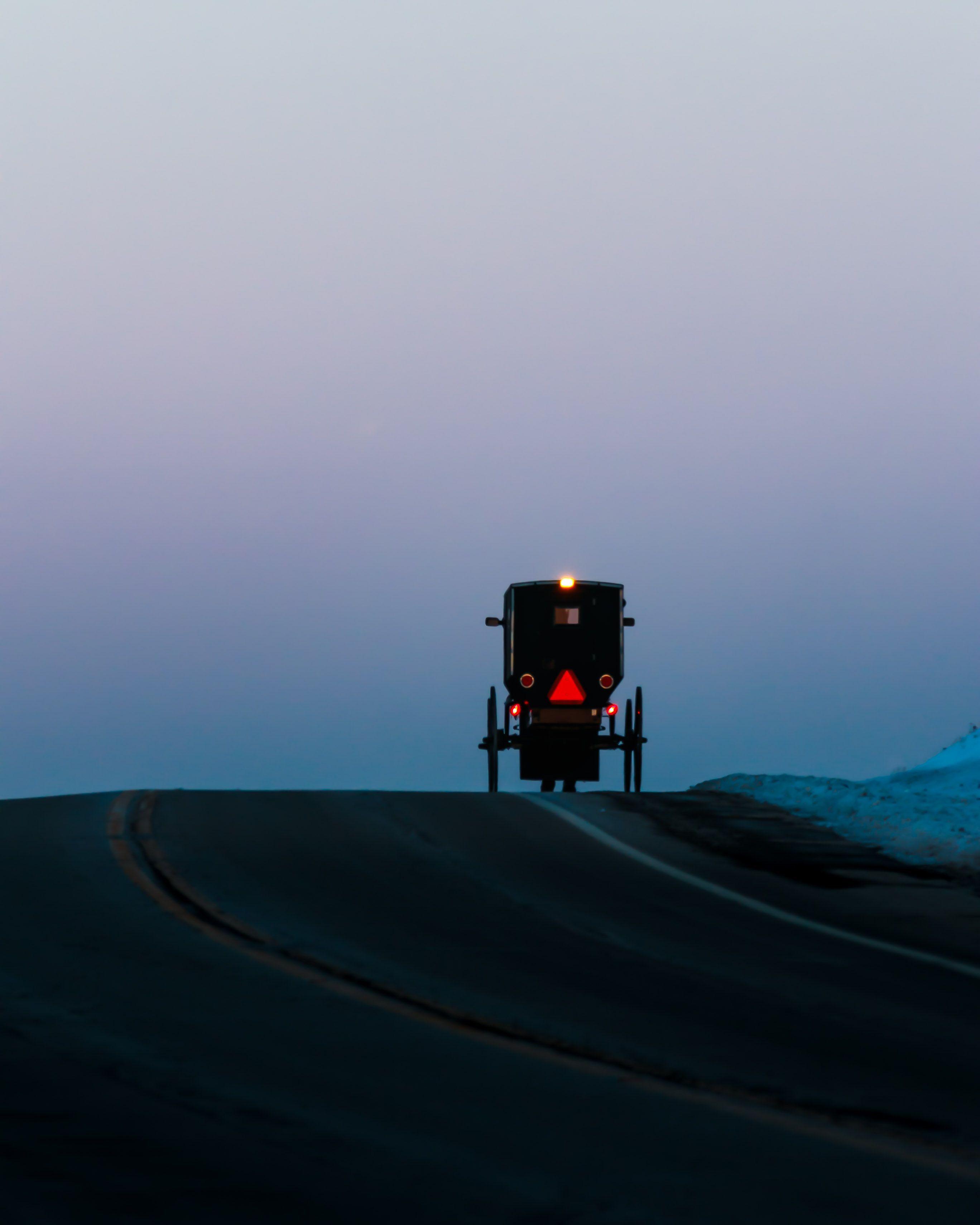 Buggy at dusk between Berlin and Winesburg Ohio. amish