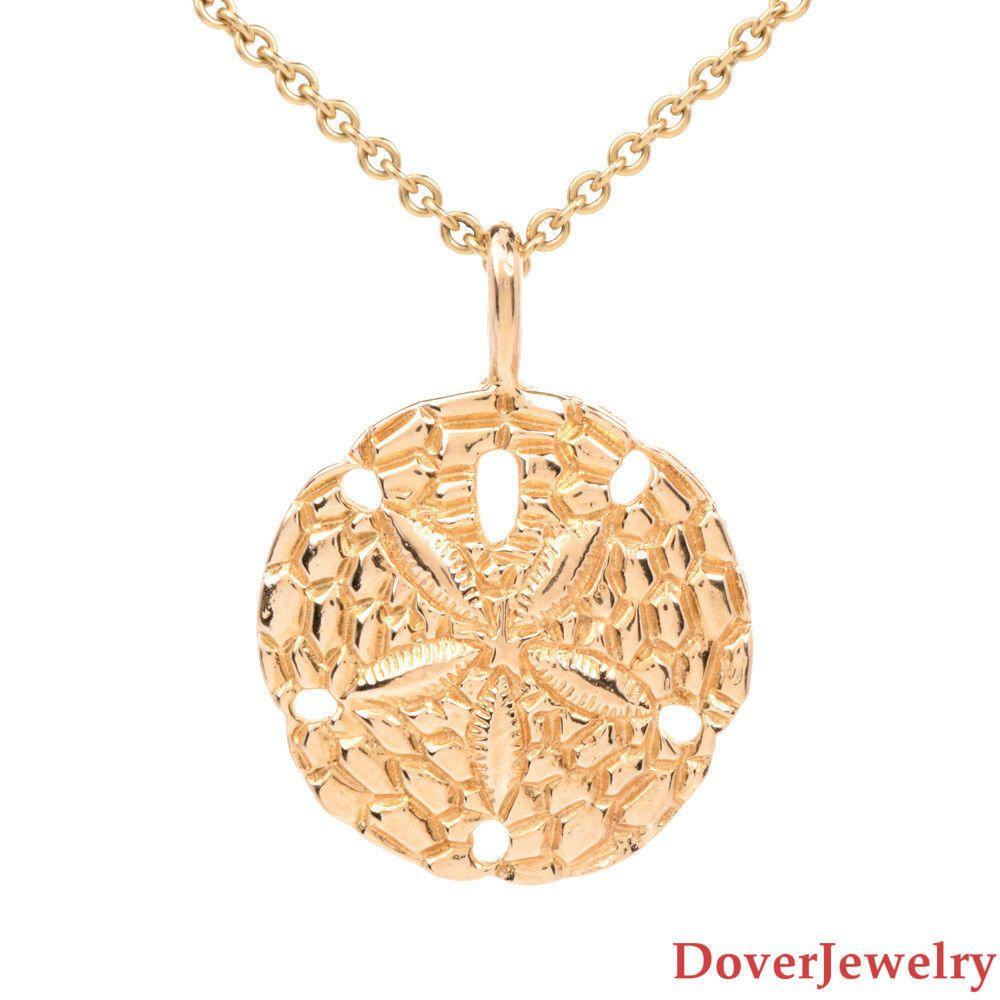 Estate k yellow gold sand dollar pendant nr fine jewelry
