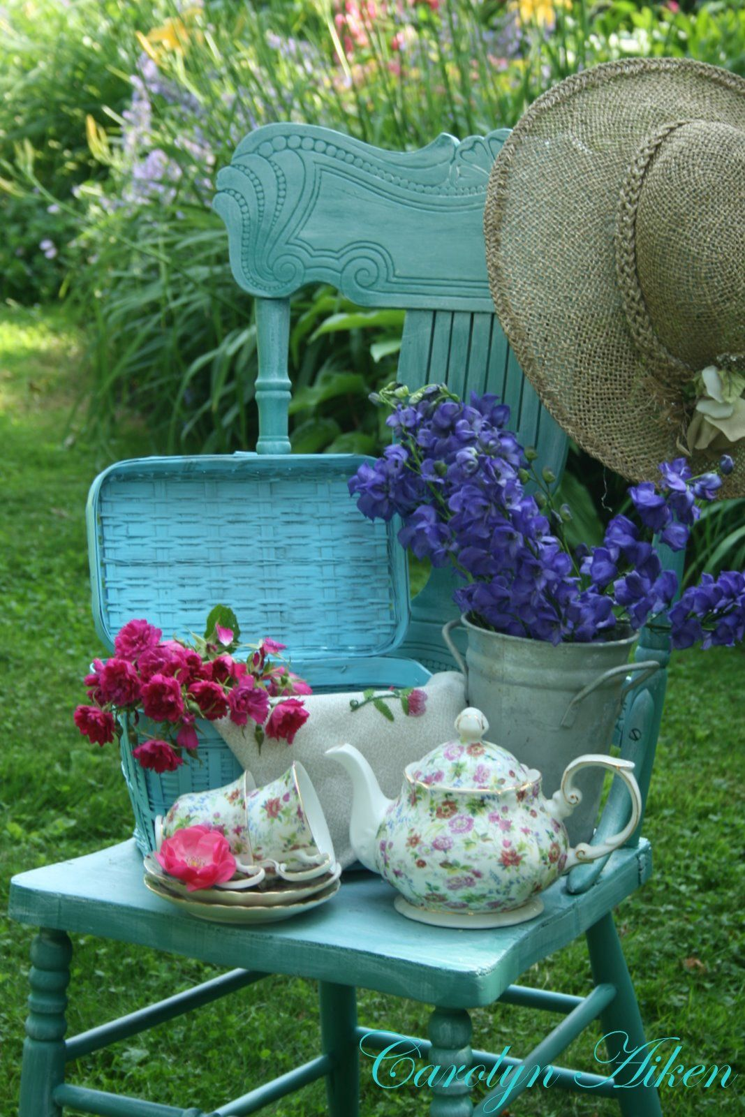 Vintage chair is a perfect backdrop for a garden.
