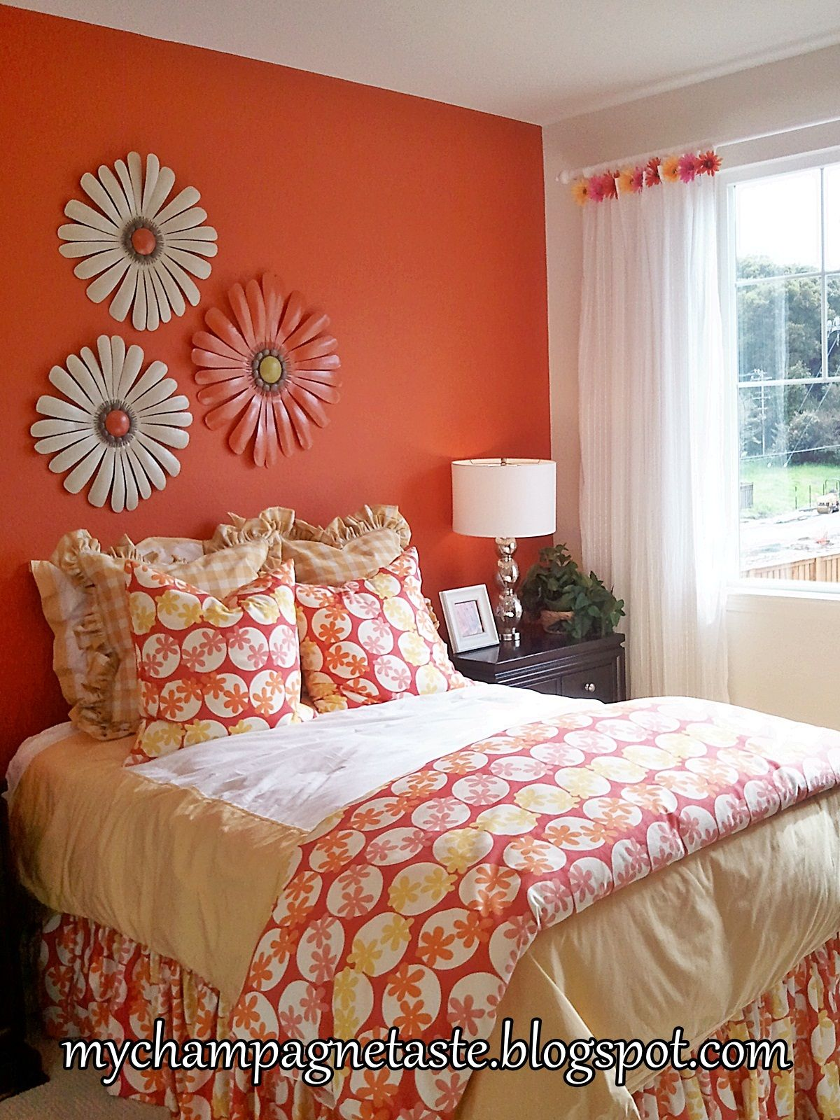 orange wall....with flowers!!! as head board.... Bedroom