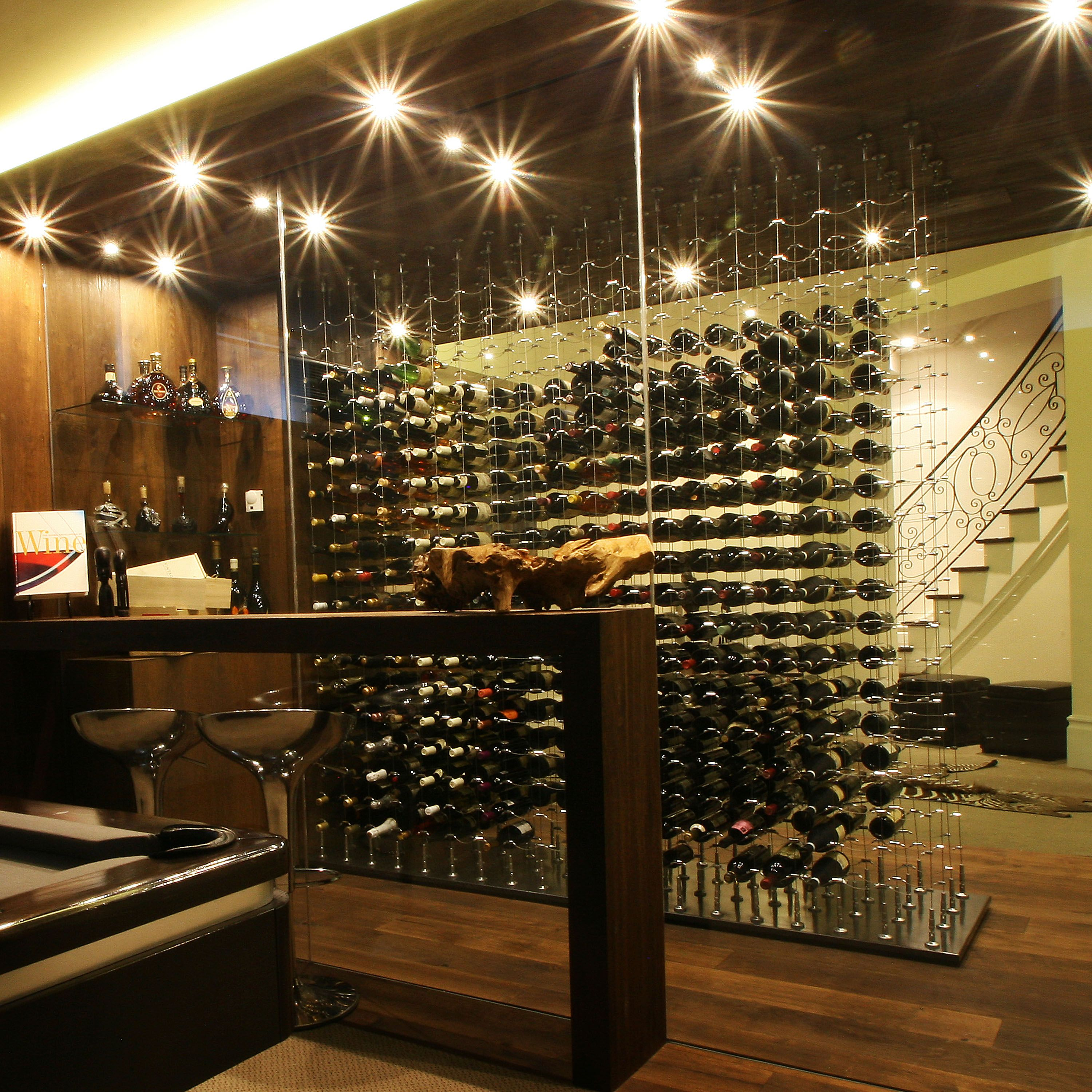 Glass enclosed wine cellar - Glass Enclosed Custom Wine Cellar Featuring Cable Wine System