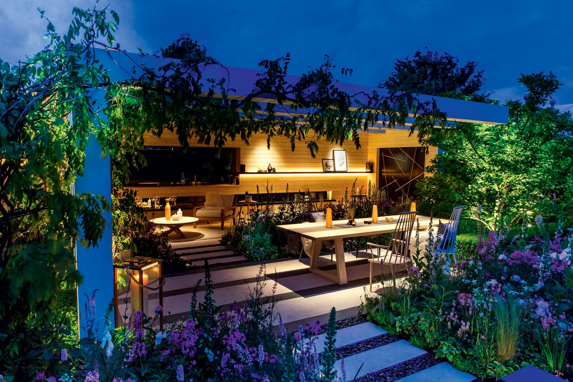 Beautiful lighting, planting and pergola with seating in