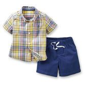 Your classic guy will love this cute outfit. A plaid top and shorts are a bright summer outfit idea.