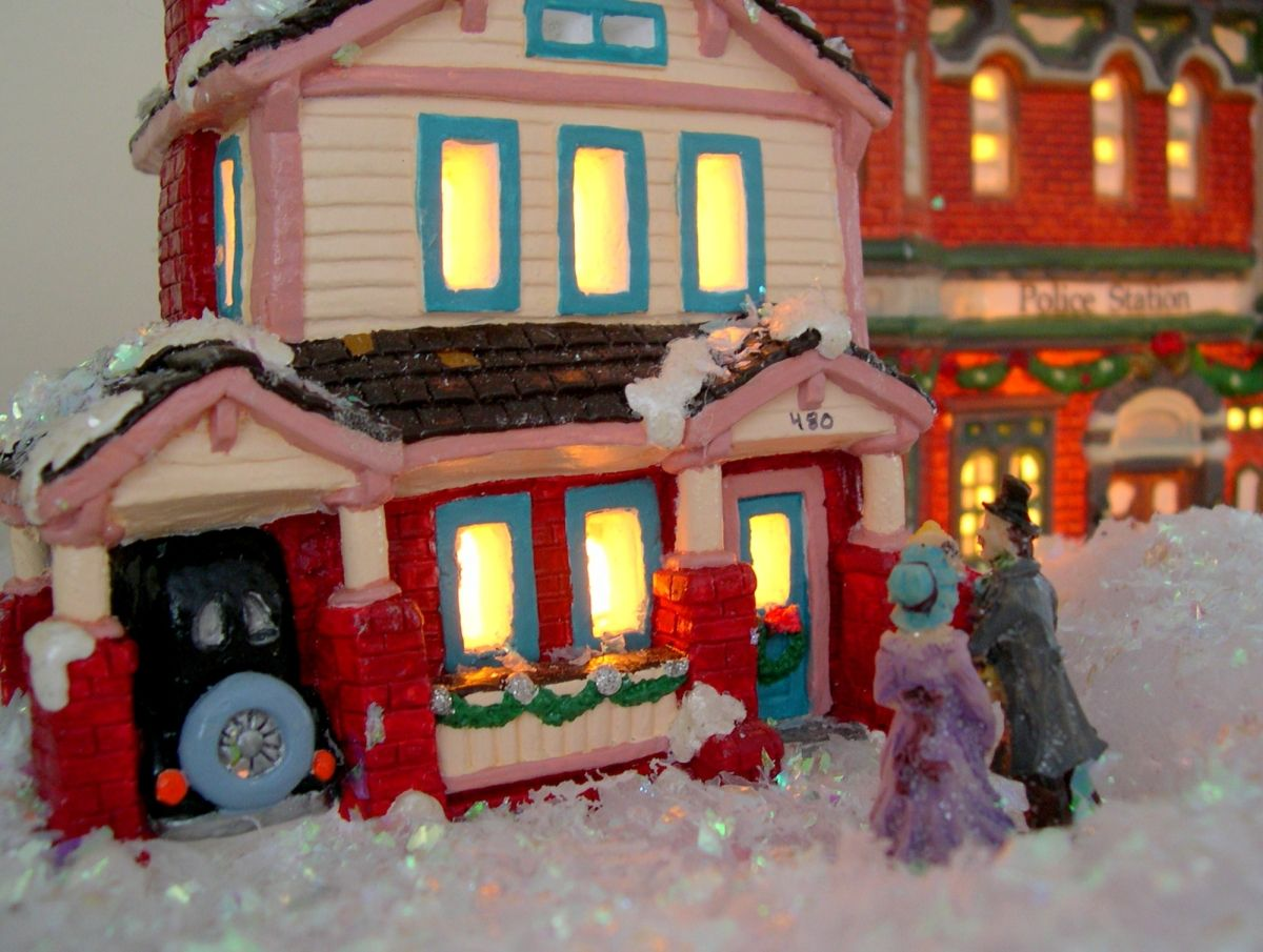 buy ceramic houses at Michaels near christmas time and paint them ...