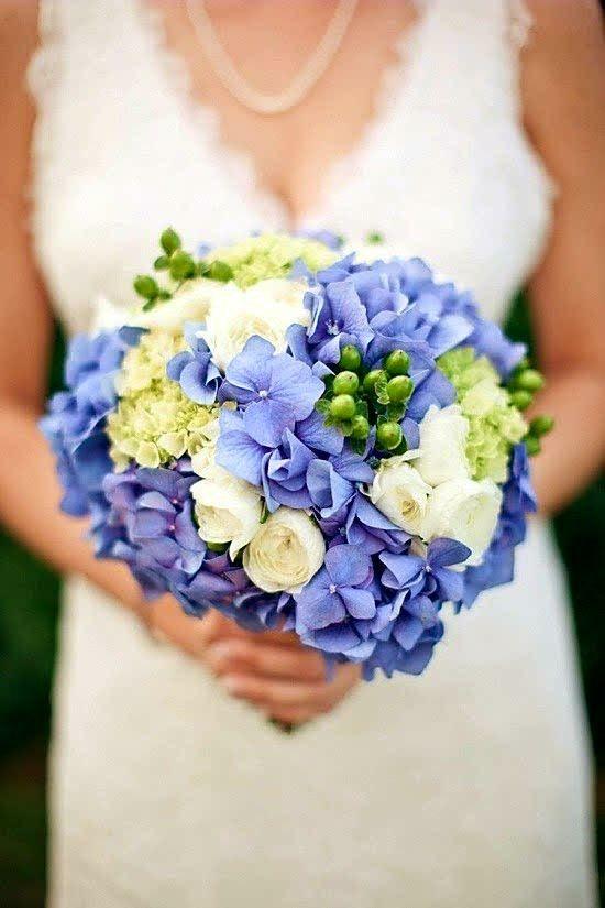Beautiful Wedding Bouquet Which Includes: Blue Hydrangea, Green Hydrangea, Green Hypericum Berries, White Ranunculus
