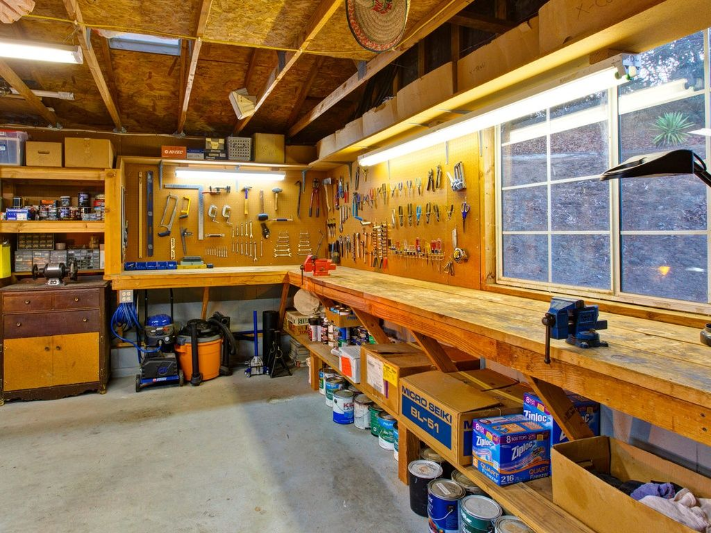 Rustic garage with concrete floors exposed beam built in for Garages and workshops