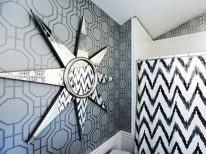Bold, graphic patterns and mirrors can help you modernize your bathroom.