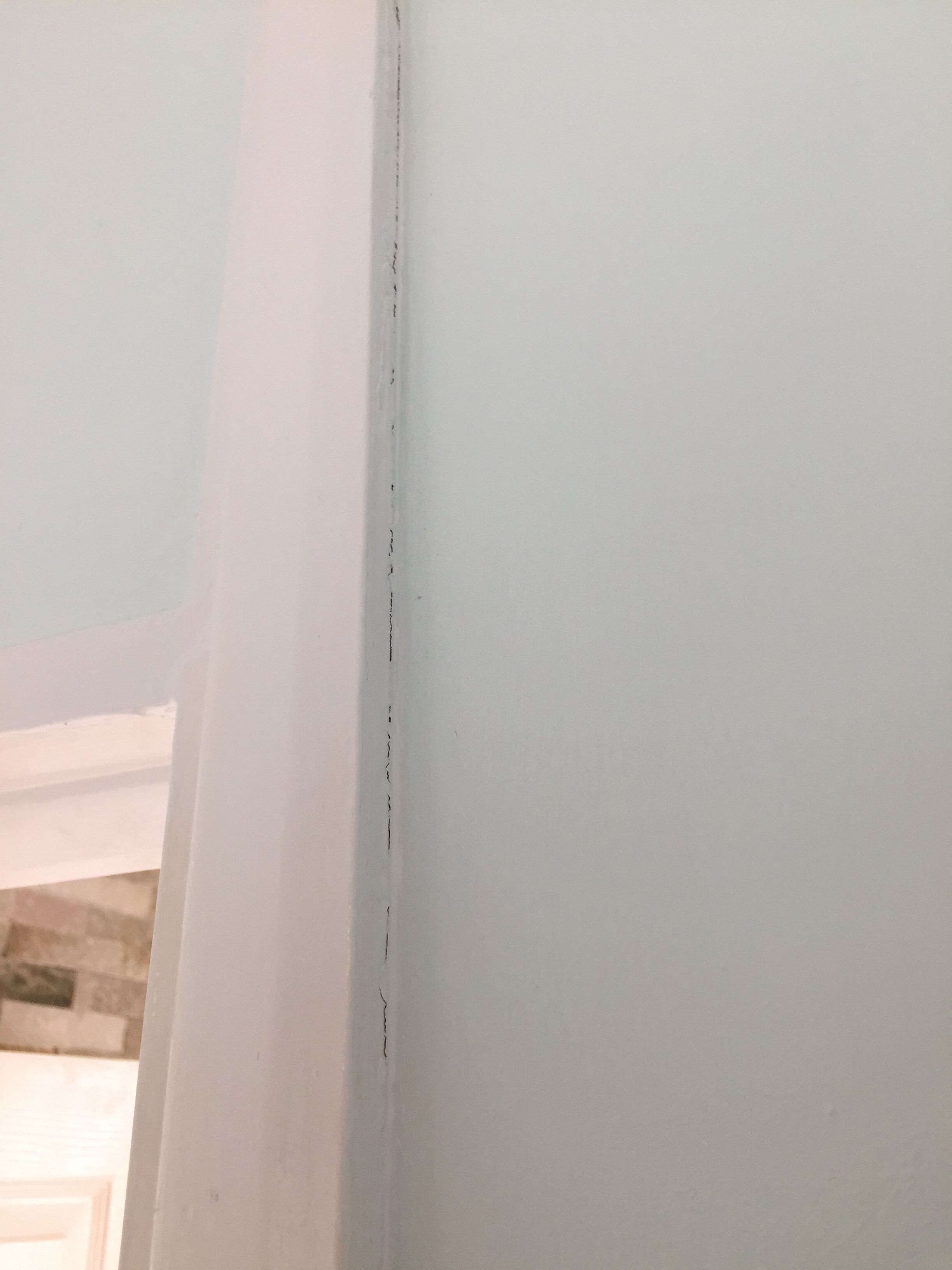 Painting cracks between painted wall and painted door frame (hallway ...
