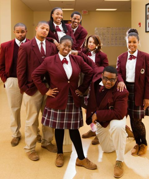 Students from the Charles A. Tindley Accelerated School wear tan slacks, a  purple blazer