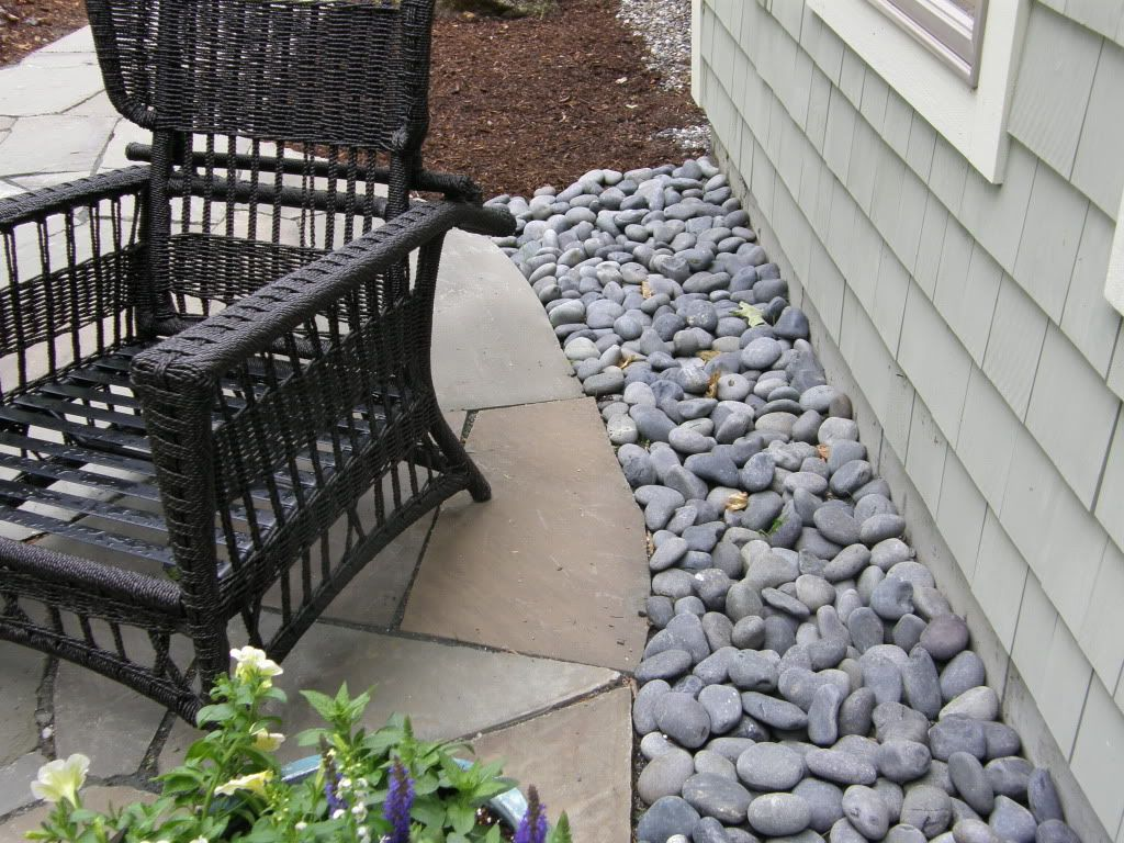 Mexican river stone front yard pinterest rock border for Landscaping rocks canada