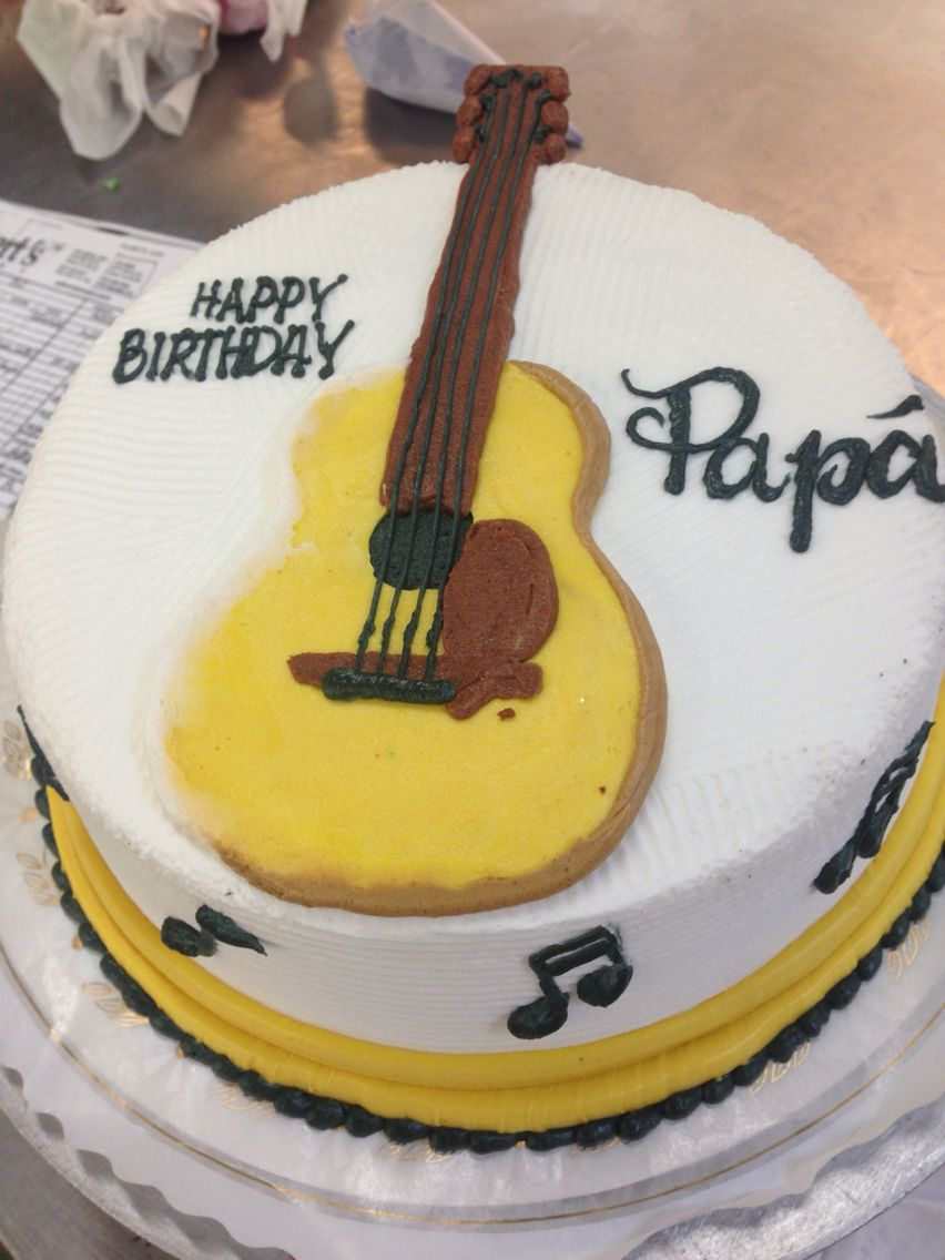 Guitars drawing on buttercream cake for birthday or music graduation