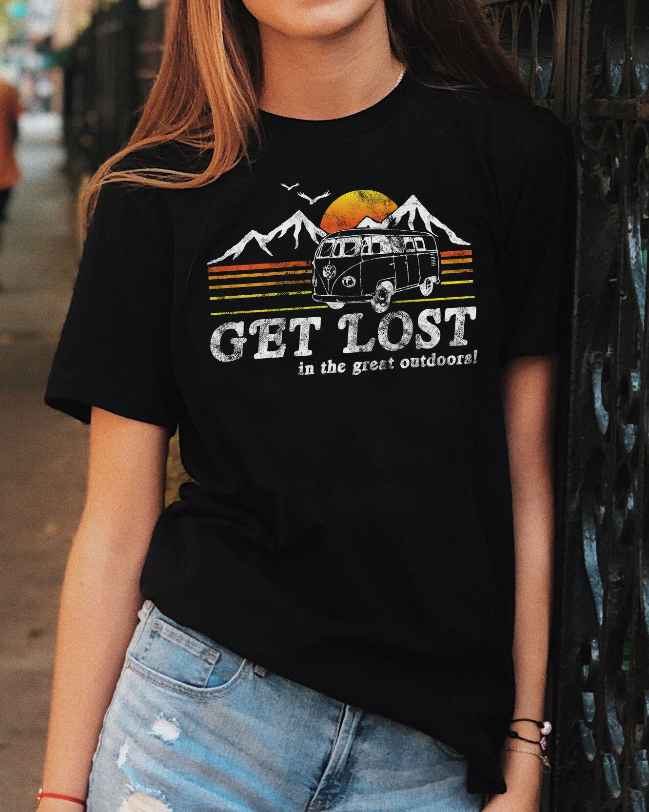 14ed64d9 Get lost in the great outdoors in this distressed, vintage style graphic tee  featuring a