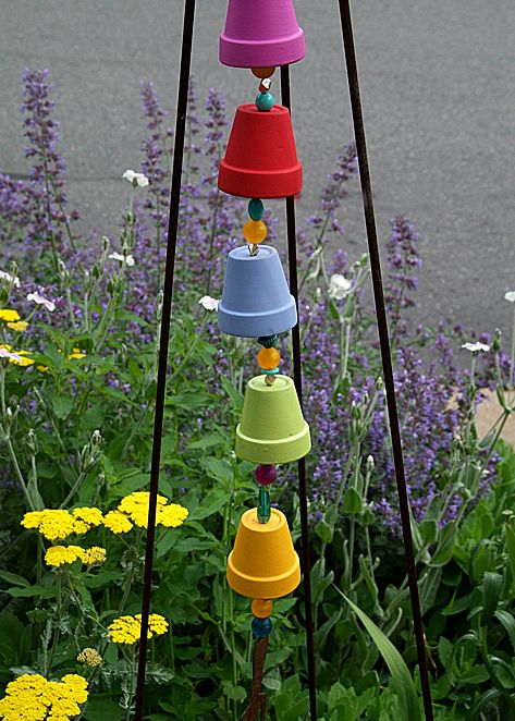 Garden Tower Chime ~ made from thick flexible craft wire; painted & sealed (so paint doesn't chip off or fade) mini clay pots; something heavier to hang at the bottom; big, colorful beads to go between & up into the pots; loop @ the top end & hang!