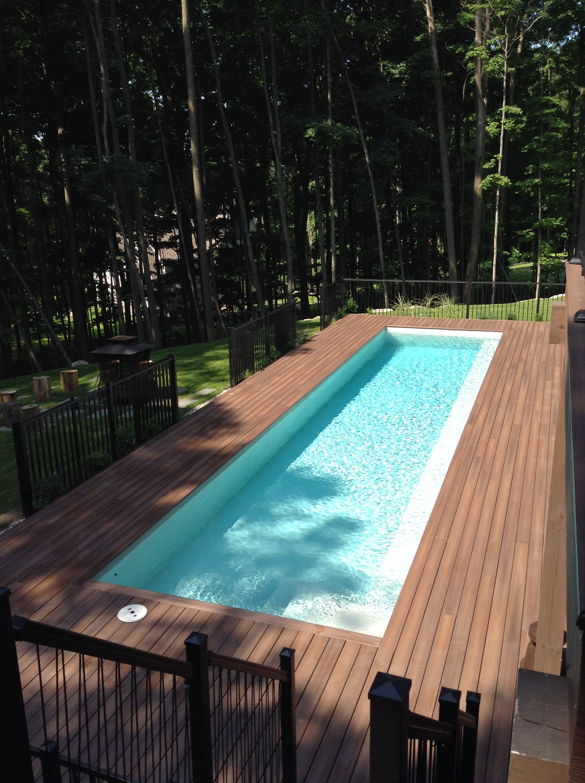 Contemporary Swimming Pool With Fiberon Composite Decking Fiberon Is A Great Building Material To Use Around Backyard Pool Designs Pool Designs Backyard Pool