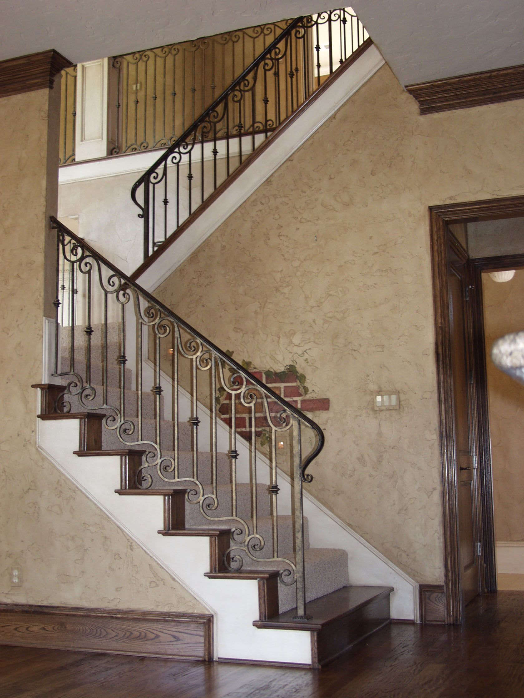 This iron staircase is made with custom fabricated ...