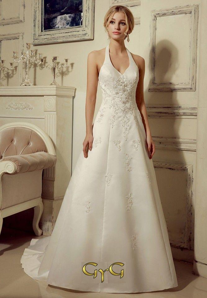 Este vestido de novia cuenta con un escote halter en forma de V que ...