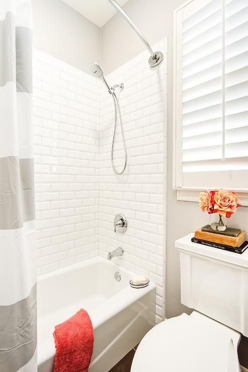 Gray And White Kids Bathroom Boasts A Bathtub Fitted With