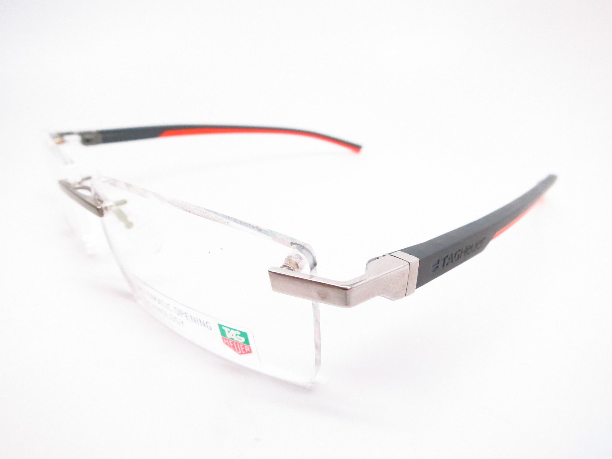 e2168f95cb Tag Heuer TH 0844 009 Orange   Grey Automatic Rimless Eyeglasses ...