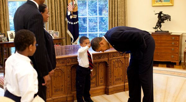 """(links to NYTimes article on the image) """"I want to know if my hair is just like yours,"""" he told Mr. Obama, so quietly that the president asked him to speak again.    Jacob did, and Mr. Obama replied, """"Why don't you touch it and see for yourself?"""" He lowered his head, level with Jacob, who hesitated.    """"Touch it, dude!"""" Mr. Obama said.    As Jacob patted the presidential crown, Mr. Souza snapped.    """"So, what do you think?"""" Mr. Obama asked.    """"Yes, it does feel the same,"""" Jacob said."""