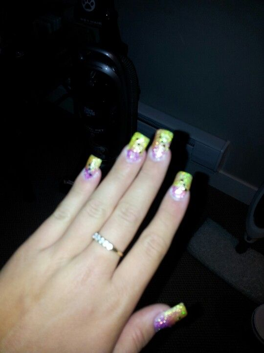 A lil blurry, tried something new. Once again sparkles from the dollar store pink and yellow and mixed it in my acrylic powder and The black dots are nail Polish dotted with toothpick