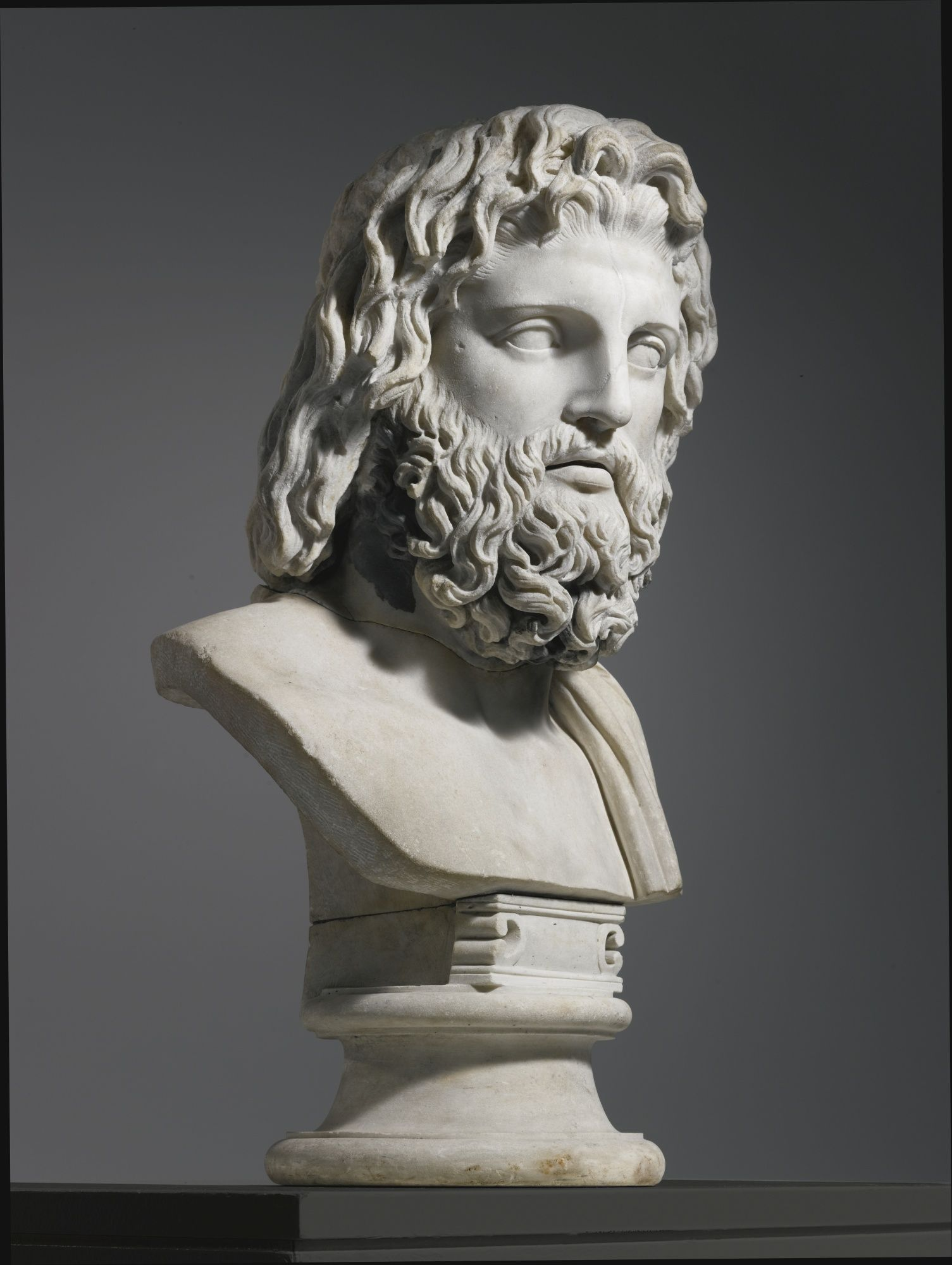 A Monumental Marble Bust Of Zeus Or Asklepios The Head Roman Imperial 2nd Century A D The Socle Shoulders And Rest Marble Bust Zeus Statue Antique Statue
