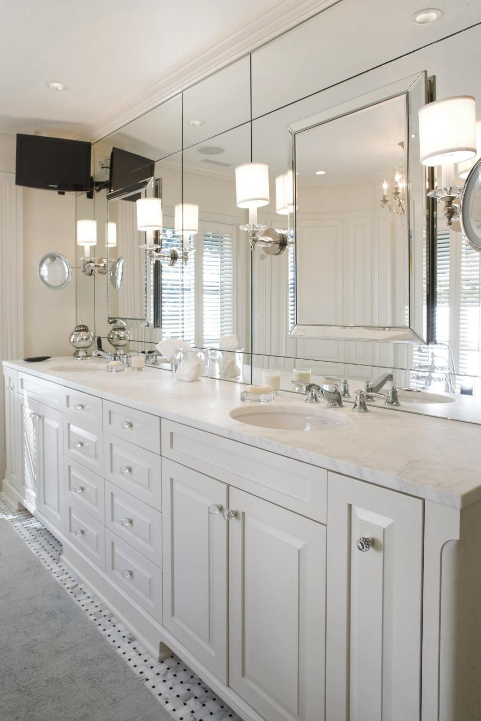 A Spacious White Vanity With A Marble Countertop Gives This Master