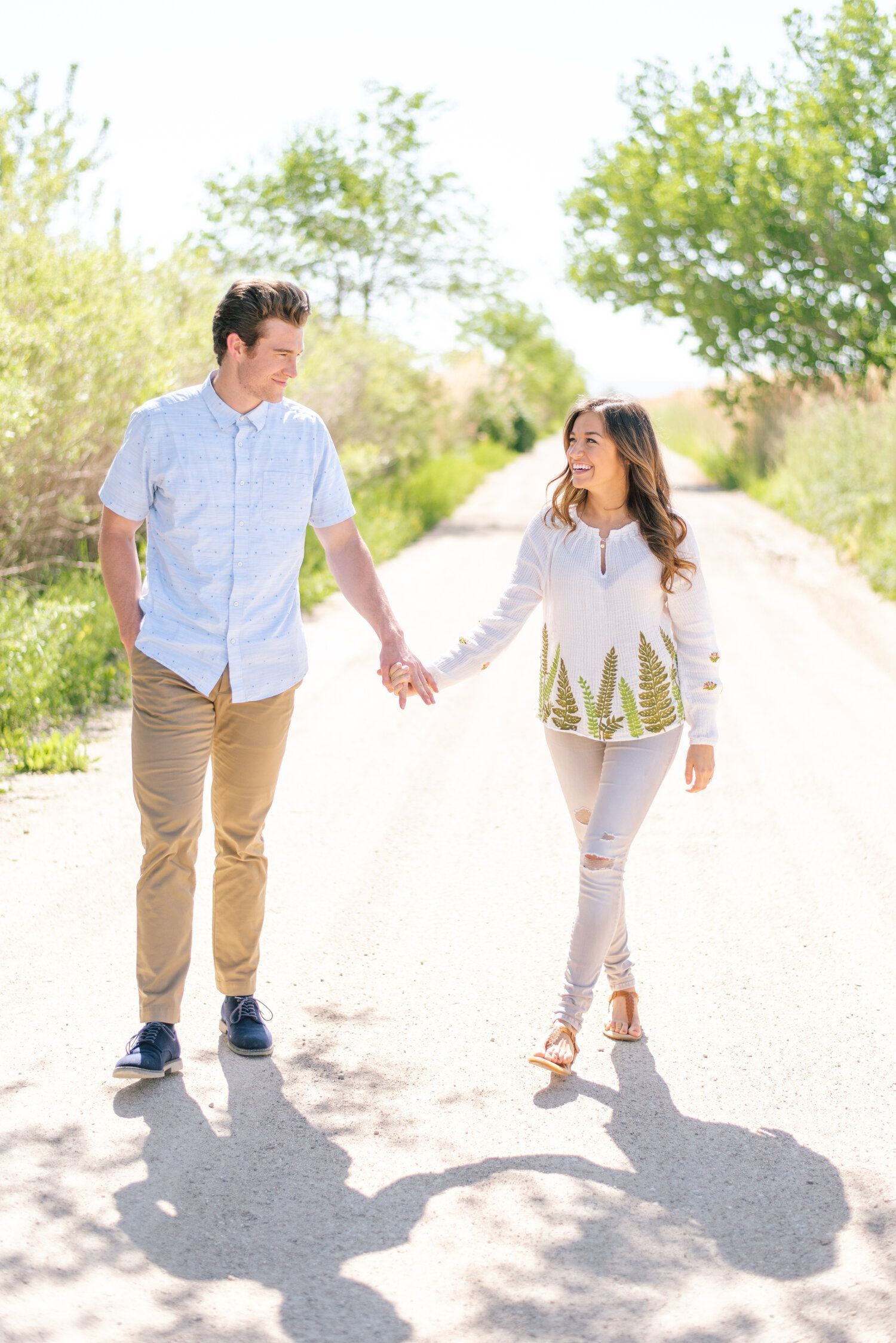 How to Prepare your Beau for Your Engagement Session | Clarity Lane -  unpaved road tall grass bright blue skies outdoor engagement session holding hands walking natural  - #Beau #Clarity #Engagement #EngagementPhotosclassy #EngagementPhotosindian #EngagementPhotoswoods #formalEngagementPhotos #Lane #naturalEngagementPhotos #plussizeEngagementPhotos #Prepare #rusticEngagementPhotos #Session #whattowearforEngagementPhotos
