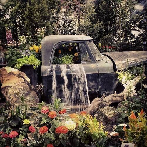 Old truck waterfall and flower bed.