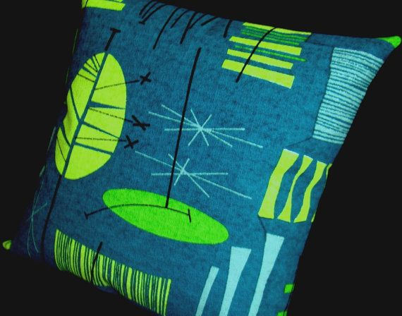 This shop makes these great throw pillows with mid century reproduction barkcloth
